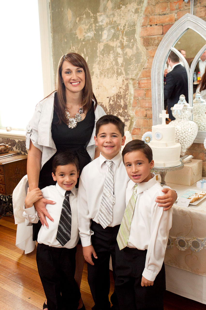 Melissa and her three boys at her eldest sons 1st Communion. The table is styled by Melissa